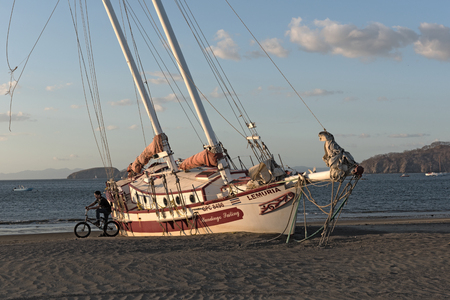 Stranded sailboat at the Playas del Coco in Costa Rica Editorial