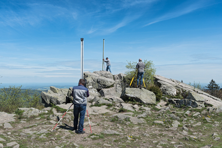 theodolite: The surveyor measures the top of the mountain