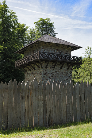 novel: Reconstructed roman limes and watchtower near former castle train coat