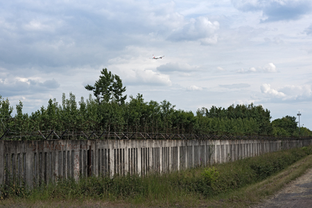 The old concrete fence at the runway 18 west of frankfurt airport