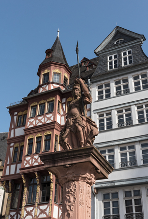 roemerberg: the minervabrunnen in front of the half-timbered houses on Roemerberg in Frankfurt, Germany