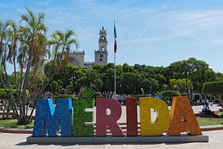 Colored lettering of the mexican city Merida with mexican flag and cathedral