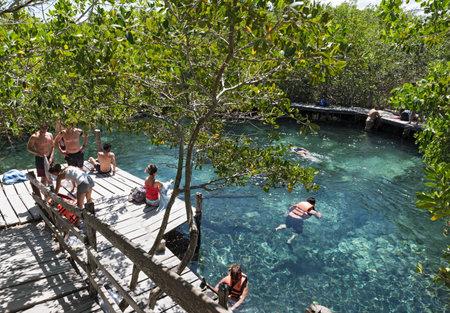 Tourists swimming in the Cenote Yalahau, Holbox, Quintana Roo, Mexico 에디토리얼