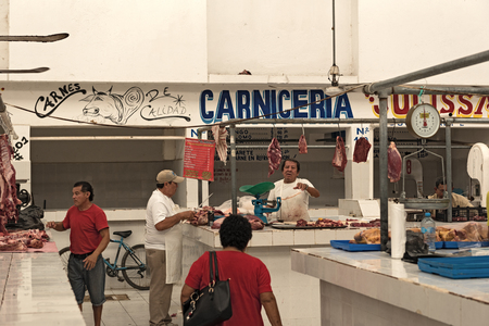Butcher in the Mercado Ignacio Manuel Altamirano, Chetumal, Mexico
