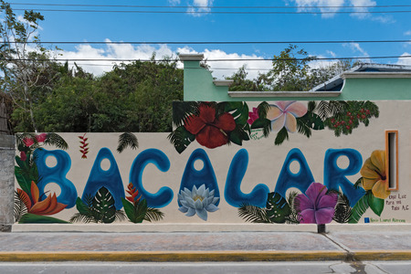 street art on a house wall in the center of bacalar, quintana roo, mexico
