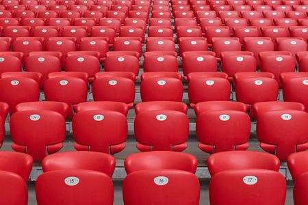 Red Plastic Chairs at the Stadium. 版權商用圖片
