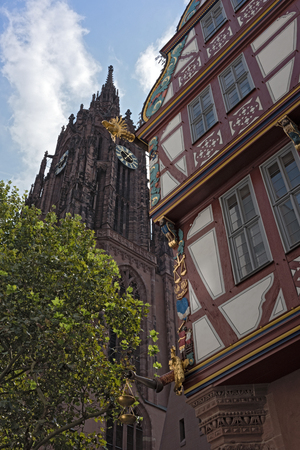 Corner detail of a colorful half timbered house, house to the Golden Libra, in the new historic old town of Frankfurt am Main, Germany.
