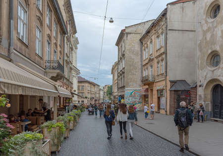 Unknown people on a pedestrian street in the old town of Lviv, Ukraine