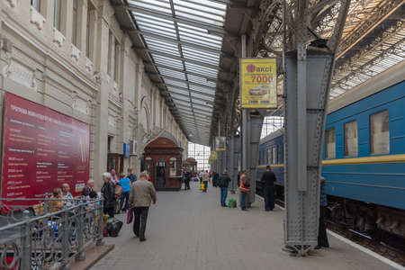 Unknown people in the main train station in Lviv, Ukraine Editorial
