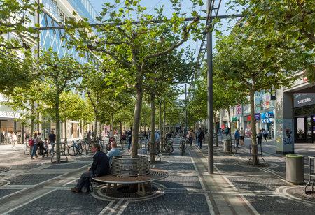 Unknown people walk down the Zeil shopping street, Frankfurt, Germany