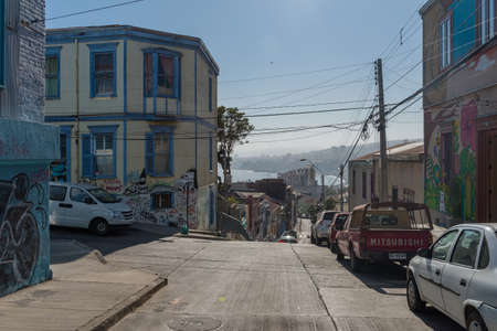 Small street with old building facades in the historic old town of Valparaiso, Chile
