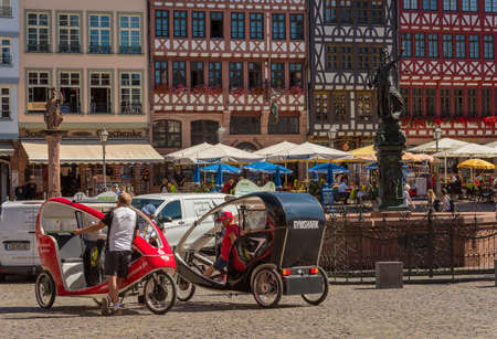 Rickshaw drivers with their vehicles on the Roemerberg waiting for passengers for a city tour, Frankfurt, Germany