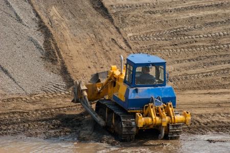 The bulldozer working in career. photo