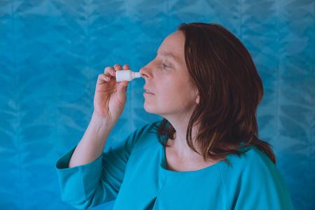Nasal Spray. Closeup Of Beautiful Young Womans Face With Nasal Drops