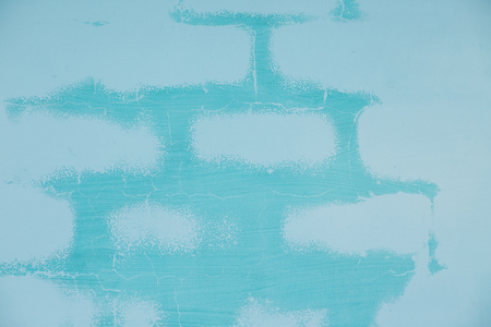 Rough textured blue wall with stains, painted cracked. Graffiti, wave lines, color mixing. Background texture