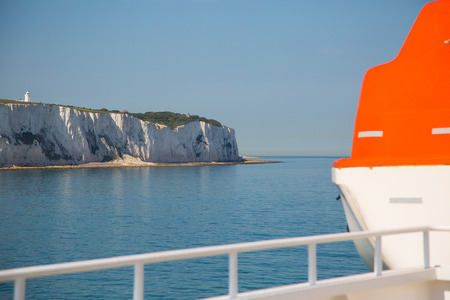 discovery channel: Lifeboat on boat in britsh channel with view on white cliffs