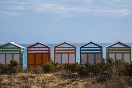 beach huts: colorful beach huts.