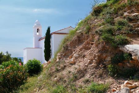 White, Romantic , latin american church behind the rock. photo