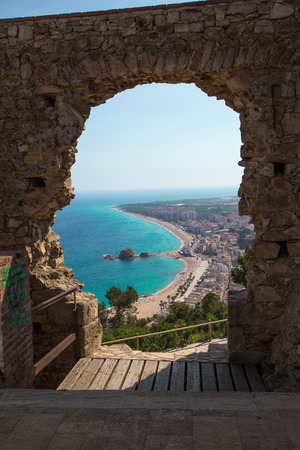 Costa Brava, overlooking the beach through the hole in a ruin.