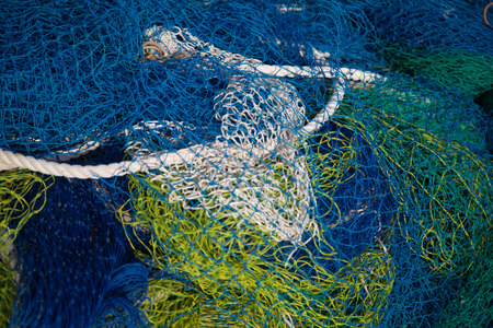 Used industrial ropes lake with fishing nets. Stock Photo