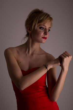 adult armpit: Lady in red posing for fashionn, Studiolight