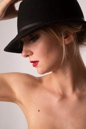 bodyparts: Lady in hat posing for fashion, Studiolight Stock Photo