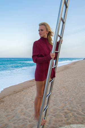baywatch: Young girl  looking into the sea from  baywatch tower