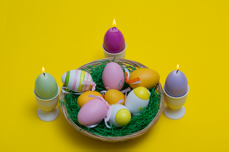 motive: Easter eggs with beautiful motive and candle.