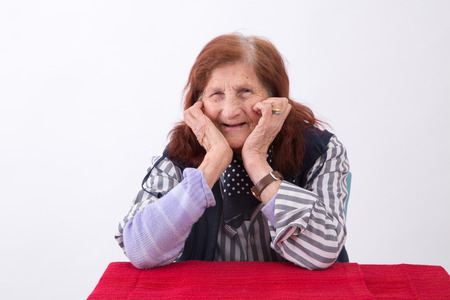 face expression: Portrait of an elderly woman with happy face expression.