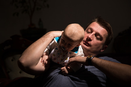 nursling: Father playing with his son. Stock Photo