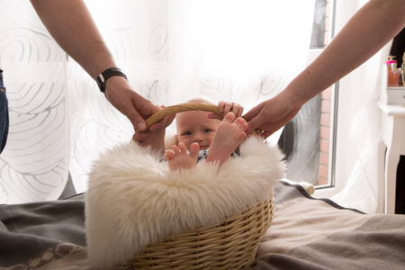 father in law: newborn baby in the basket. Stock Photo