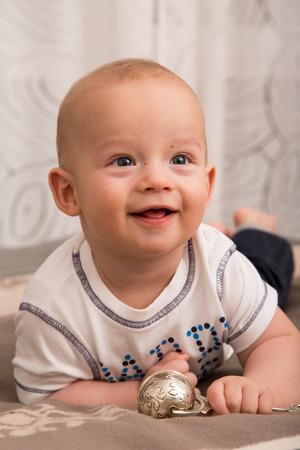 nursling: Portrait of cheerful newborn boy.