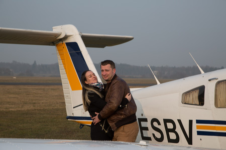 monoplane: Wife hugging her husband after the flight.