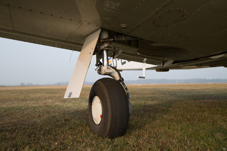 monoplane: Retractable landing gear of single-engine aircraft. Stock Photo