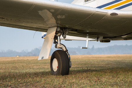 retractable: Retractable landing gear of single-engine aircraft. Stock Photo