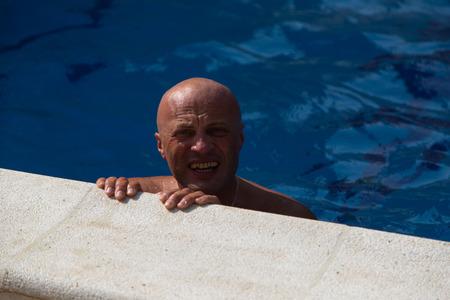 break in: Swimmer makes break in the swimming pool.