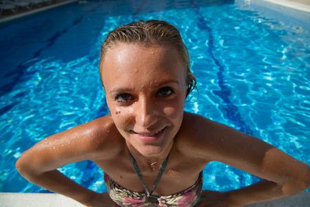 swimm: Sexy girl in bikini swimms in swimming pool.
