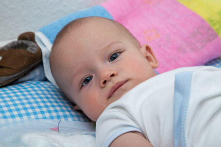 nursling: Newborn boy on the changing table. Stock Photo