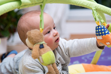 nursling: Portrait of a cheerful newborn.
