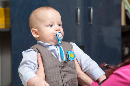 nursling: Very serious newborn boy in a suit