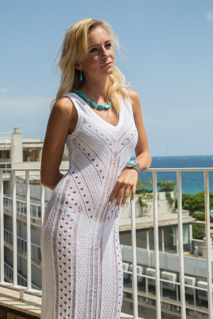 Lady in transparent  Lace Dress with turquoise jewelry Stock Photo
