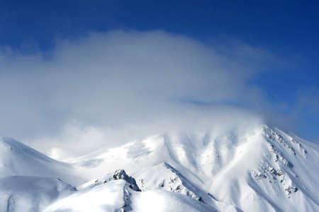 mountainscape: A photo of a snow mountain peak Stock Photo