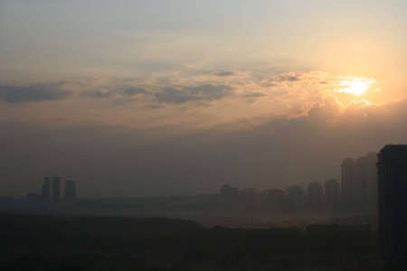 Sunset over city Stock Photo