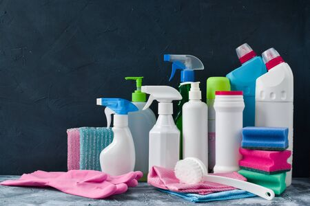 Various bottles for washing sponges, rags and gloves with brushes. Everything for cleaning in one place. Inventory for the maid. Stok Fotoğraf