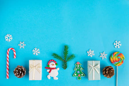 Small Christmas toys lie at the bottom of the frame. Top View Flatlay Layout