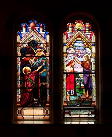 window: Stained glass window with religous motifs Editorial