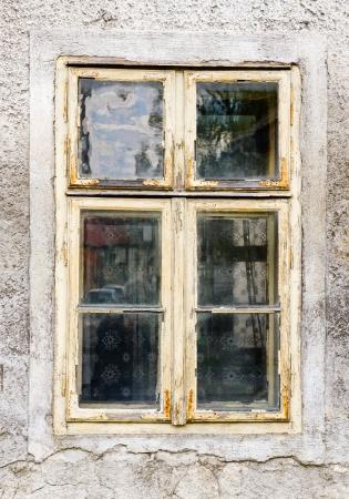 Old window with peeling paint