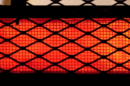 Red hot wires on electric heater - background   pattern Stock Photo
