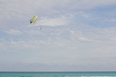 parachute sailing  over the ocean Stock Photo