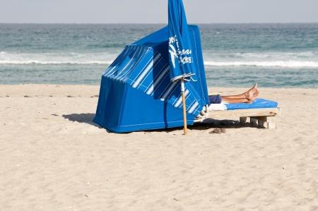 Woman on a beach lounge